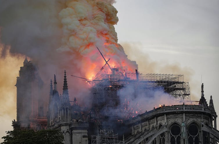 The spire collapses while flames are burning the roof of the Notre-Dame Cathedral in Paris, France. Ian Langsdon/EPA