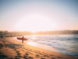 Australian surfer   Photo by Alex King on Unsplash