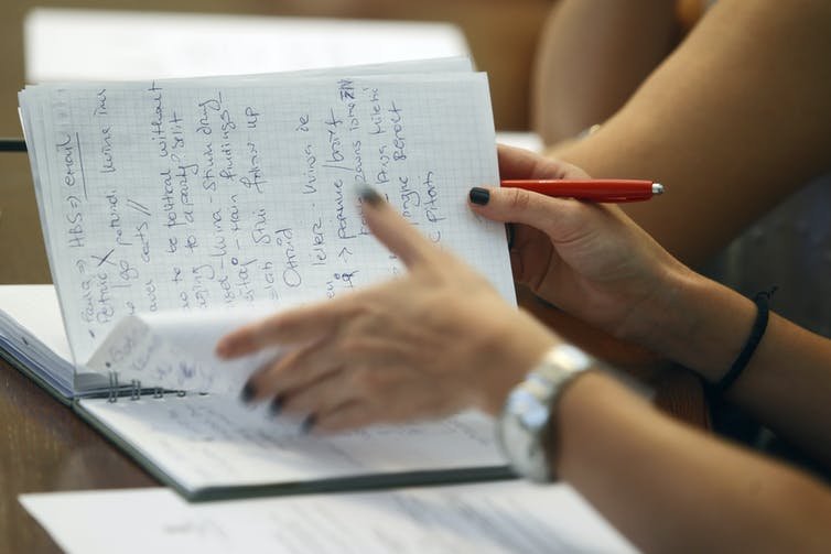 If you're just copying down what the lecturer says and you don't revise what you've written down, there's little point in taking notes. Photo: Shutterstock