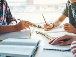 study, tutor, students | Shutterstock
