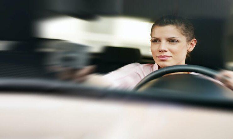 Woman driving | Diego Cervo/Shutterstock